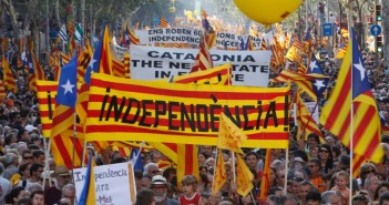 """People hold banner reading """"independence"""" during a protest for greater autonomy for Catalonia within Spain in Barcelona"""